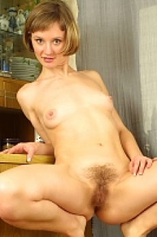 blonde girl spreading her hairy pussy