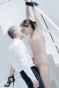 Caprice is tied up to the stairs by Mr.Grey