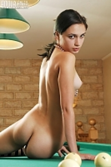 sexy thin girl posing naked on a billiards table