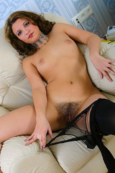 Beautifully hairy Avery on leather chair