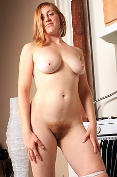 Jessica teases and spreads her wonderful hairy pussy on the kitchen bench.