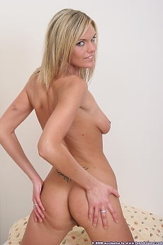 Stunning blonde shows off her perfect ass and breasts