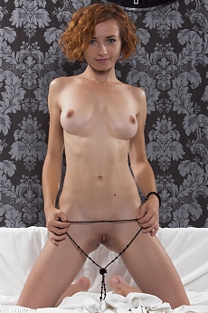 A skinny redhead with a sexy body posing naked in these pics