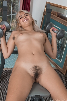Candy Wallace exercises while stripping naked