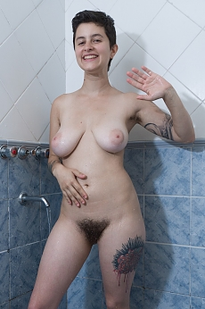 Sue undresses and takes a very wet shower