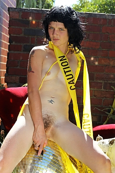 angled up in yellow tape, Lady takes a wank , sprawling over a luxurious red velvet armchair, a giant disco ball throws flecks of light across her petite body as the golden vibrator slips in and out of her succulent hairy pussy.