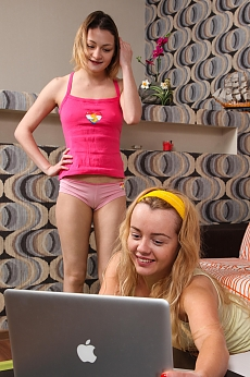 Hot teen lesbians Olivia Devine and Bella G toy their twats