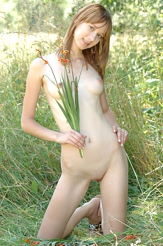 extremely skinny teen posing naked in nature